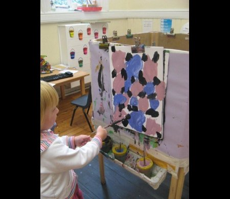 One of the nursery children painting patterns