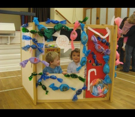 Nursery children playing in the Hansel and Gretel's House